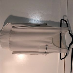 Tops - White sleeveless blouse with zippers.